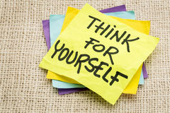 Think for yourself. Advice on a sticky note against burlap canvas stock images