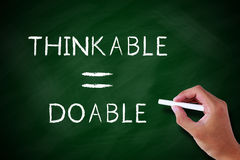 Thinkable and doable, Positive Concept. Positive thinking concept written on blackboard or chalkboard, white background Stock Image