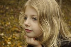 The Thinker. Cute little girl version of The Thinker Stock Photography