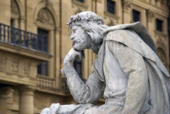 Thinker. Statue of a medieval man sitting in a thinker position Royalty Free Stock Photography