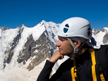 Thinker. Climber on the top of mountain. Thinker Stock Photo