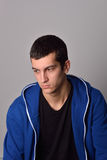 Thinker attractive young man in blue hoodie Royalty Free Stock Image