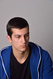 Thinker attractive young man in a blue hoodie Stock Images