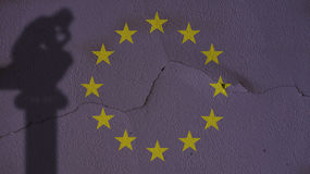 Thinker Shadow on Europe Flag and Concrete Wall Stock Images