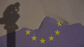 Thinker Shadow on Europe Flag and Grey Concrete Wall Royalty Free Stock Photography