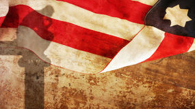 Thinker Shadow on Wood. With Usa Flag Royalty Free Stock Image