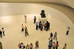 The Thinker at Soumaya Museum. People admiring The Thinker sculpture by Rodin. Image taken at Soumaya Museum in Mexico City Stock Photos