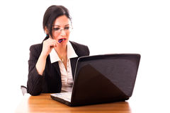 Thinkful Businesswoman. In front of her laptop Stock Photos