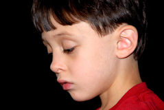 Thinking. A child in deep thought thinking over his situation Royalty Free Stock Photos
