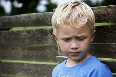 Thinking. 5 year boy thinking outdoor Royalty Free Stock Photo