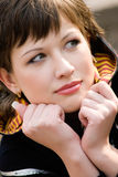 Thinking. Portrait of beautiful young woman Stock Image