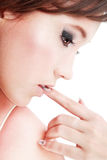 Thinking. Close-up portrait of beautiful pensive girl with finger in her mouth Stock Photo