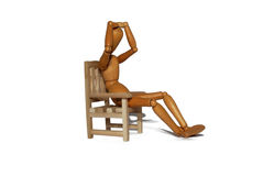 Thinking. Contemplating and thinking in a wooden chair Royalty Free Stock Image