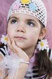 Thinking. Pretty little girl with a beautiful outfit, thinking stock photos
