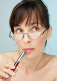 Thinking. Women thinking with pen and eyeglasses Stock Images