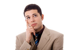 Thinking. Young business man thinking white isolate Royalty Free Stock Image