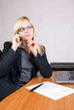 Thinking about. Business woman thinks about the offer on the telephone Royalty Free Stock Image