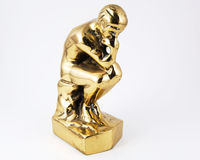 Thinking About It. Thinking man in brass isolated on a white background Stock Image