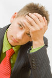 Thinking. Young businessman thinking about he's job Stock Images
