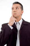 Thinking adult businessman looking aside Stock Photos