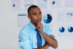 Thinking african american businessman