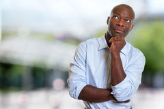 Thinking african american businessman Royalty Free Stock Images