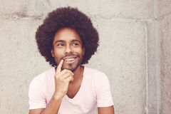Thinking african american hipster man. Outdoors in vintage retro look royalty free stock images