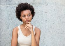 Thinking african american young adult woman. Outdoors in summer royalty free stock photo