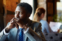 Thinking African Businessman in Cafe royalty free stock photo
