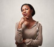Thinking african woman Stock Images