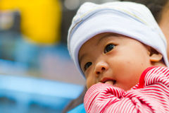 Thinking asian baby Stock Photos