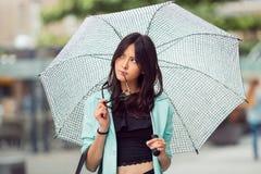 Thinking asian girl city portrait. Stock Photo