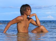 Thinking Asian male. Asian male portrait, looking over the sea, at the beach of the marine sanctuary of Apo Islands, Negros Oriental, Philippines stock photography