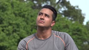 Thinking Athletic Hispanic Adult Male. A handsome adult hispanic man stock footage