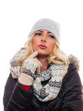 Thinking about it. A attractive blond woman dressed for winter is in deep thought royalty free stock photos