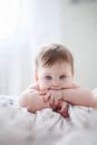 Thinking baby. Portrait of baby girl, thinking. Closeup Royalty Free Stock Photography