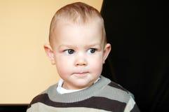Thinking baby Stock Photo
