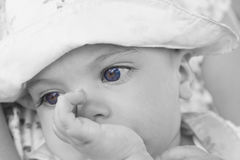 Thinking baby girl Stock Photography