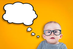 Thinking baby with glasses Stock Photo