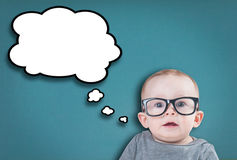 Thinking baby with glasses Stock Photography