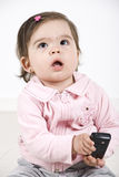 Thinking baby holding phone mobile Stock Images