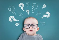 Thinking baby with questions Stock Images