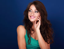 Thinking beautiful curly hair style woman looking on blue backgr Royalty Free Stock Images