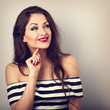 Thinking beautiful funny makeup woman with red lipstick looking stock photos