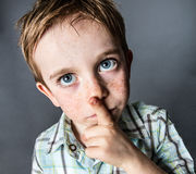 Thinking beautiful young boy with big blue eyes looking up Royalty Free Stock Photo