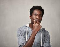 Thinking black man Stock Photo