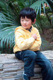 Thinking boy. Reflection of the boy sitting in windowsill Royalty Free Stock Photography