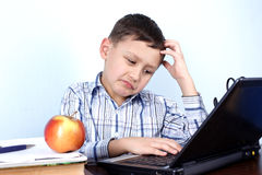 Thinking boy at PC Stock Images