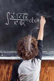 Thinking boy solving equation with smoking head Royalty Free Stock Images
