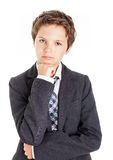 Thinking. Boy in white shirt, tie and Jacket looking at the camera having a thoughtful look Stock Photo
